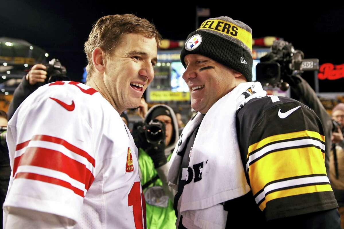Steelers quarterback Ben Roethlisberger, right, and Giants quarterback Eli Manning visit after their game on Dec. 4.