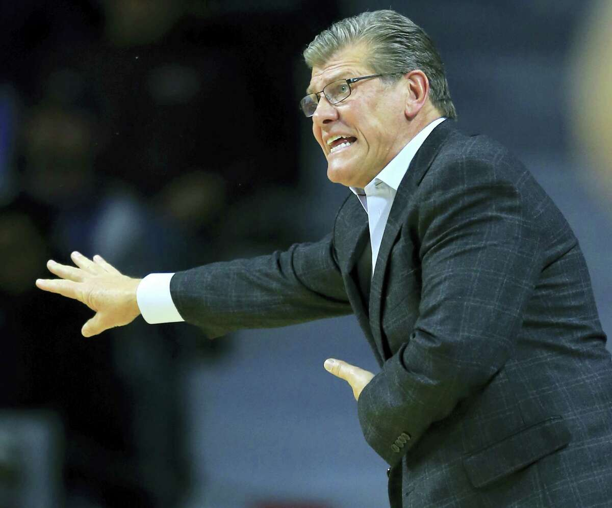 UConn coach Geno Auriemma directs his team during the first half against Kansas State on Sunday.