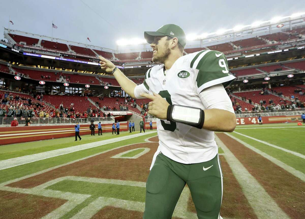 Jets quarterback Bryce Petty smiles as he runs off the field after the Jets beat the 49ers in overtime on Sunday.