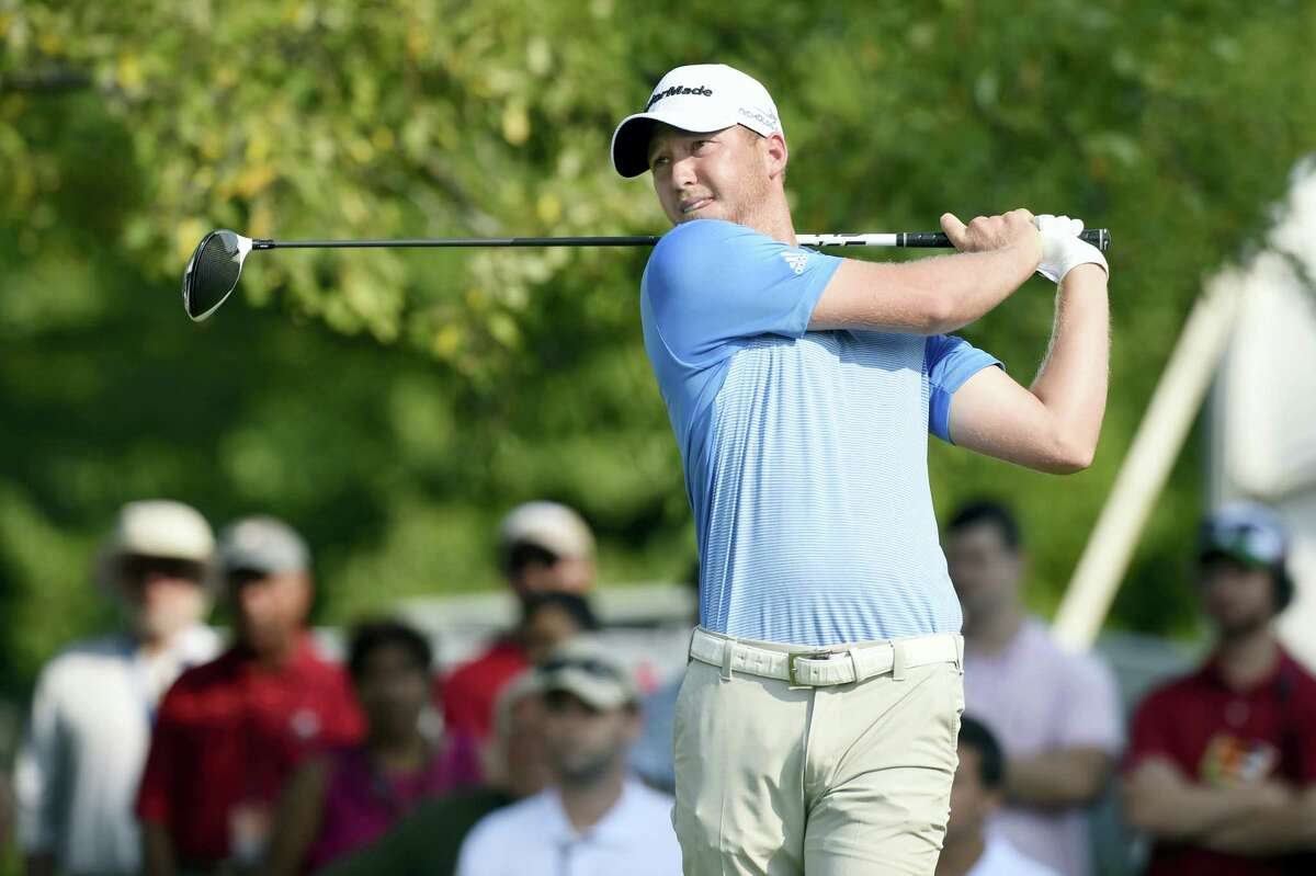 Daniel Berger watches his tee shot on the first hole during the third round of the Travelers on Saturday.