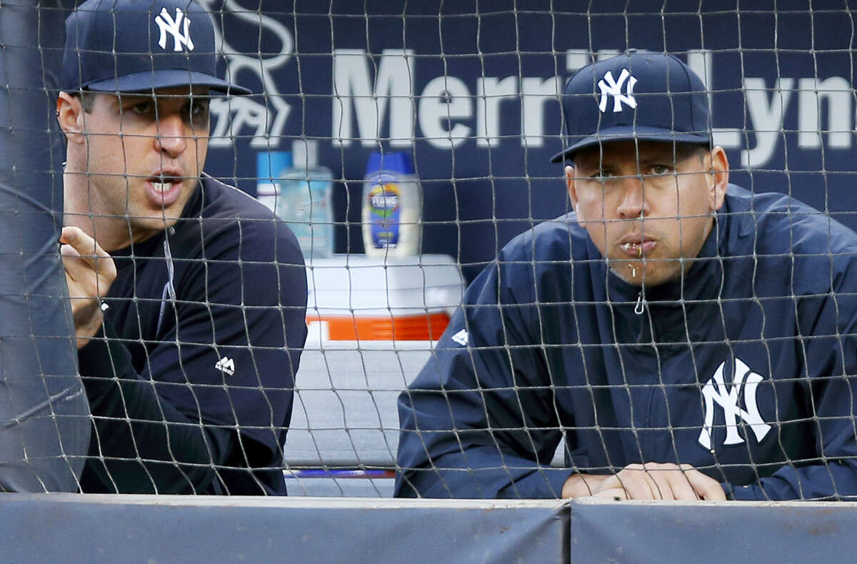 New York Yankees' Mark Teixeira, left, and Alex Rodriguez sit out the team's game on Thursday.