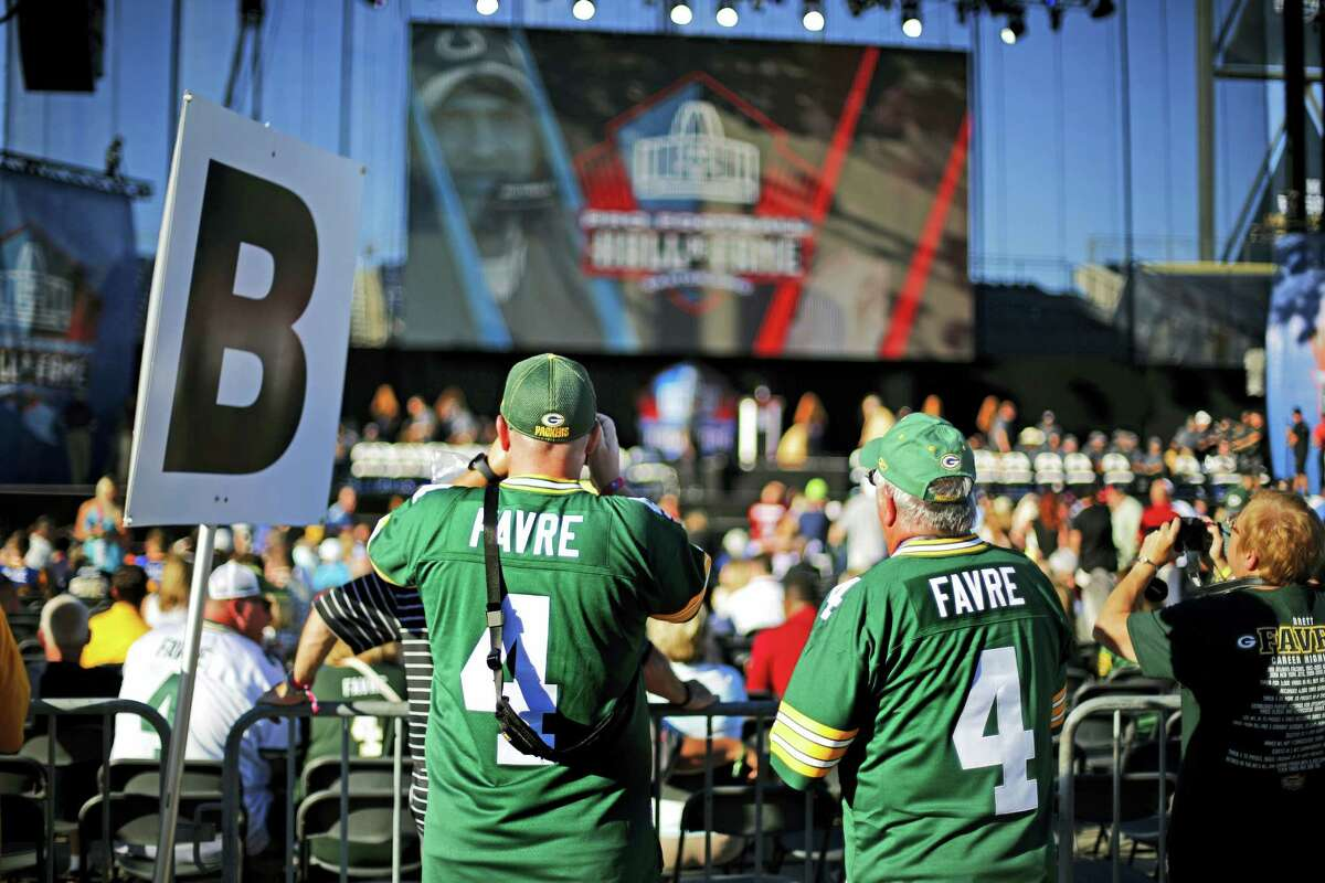 Brett Farve fans wait for the beginning of induction ceremony at the Pro Football Hall of Fame on Saturday.