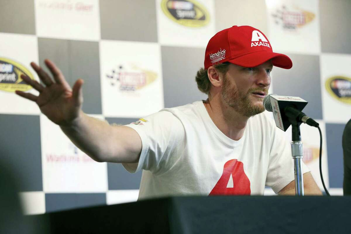 Dale Earnhardt Jr. answers a question while addressing the media at Watkins Glen International racetrack on Friday.