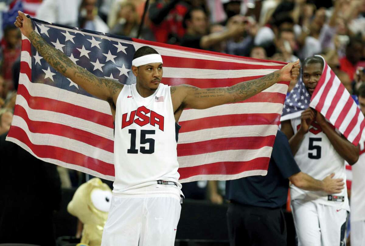 Carmelo Anthony celebrates after the men's gold medal basketball game at the 2012 Summer Olympics in London.