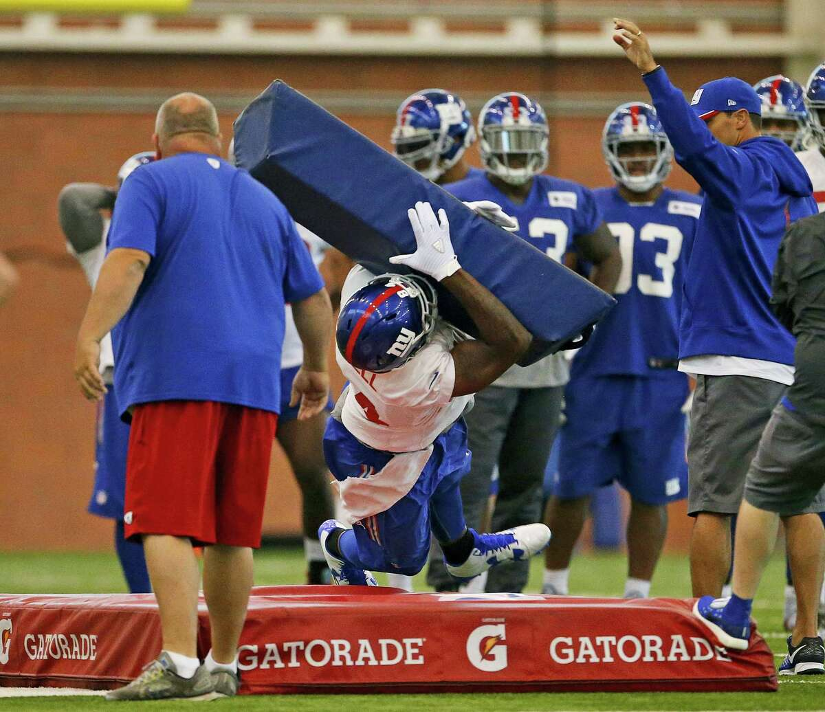 Giants tight end Larry Donnell dives at a blocking pad during a recent practice.