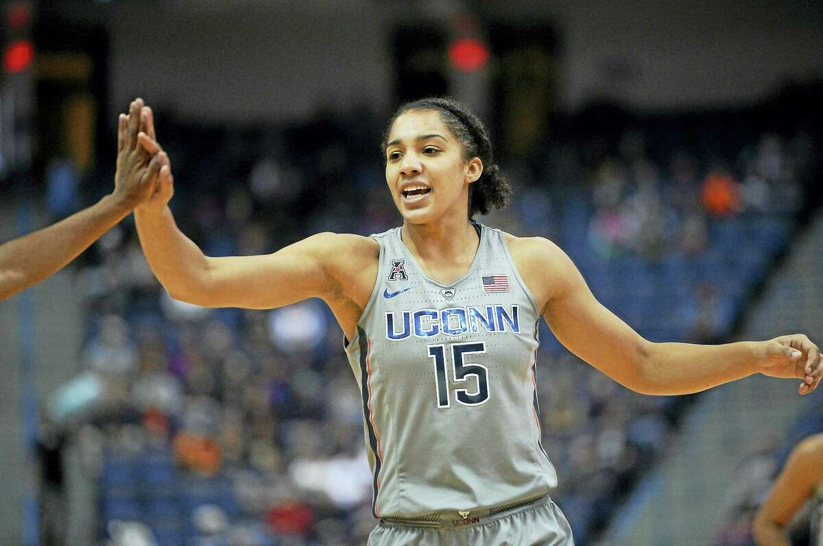 UConn's Gabby Williams high-fives a teammate during a game earlier this season.