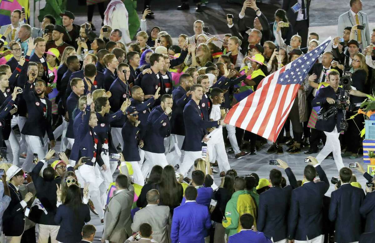 Michael Phelps carries the flag of the United States during the opening ceremony for the 2016 Summer Olympics in Rio de Janeiro, Brazil, on Friday.