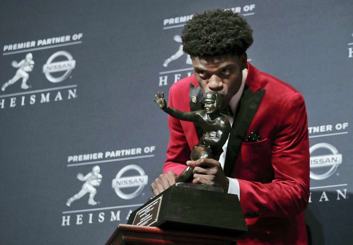 Louisville's Lamar Jackson poses with the Heisman Trophy after winning the award on Saturday in New York.