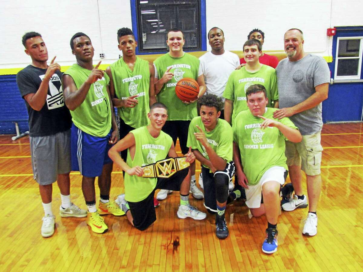 Photo by Peter Wallace The Torrington Kings, featuring three players from Waterbury Career Academy, won the Torrington Summer Basketball League's varsity division championship Friday night in a preview look against a team from Torrington High School's varsity.