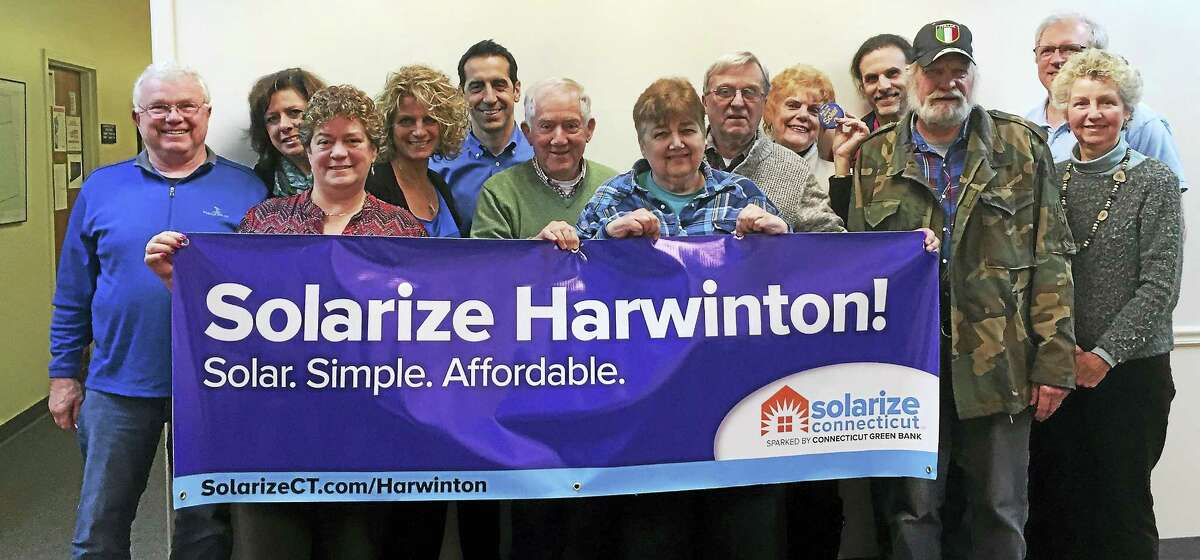 Contributed photoResidents who signed up for solar energy service through Solarize Harwinton gather for a recent photograph at the town hall.