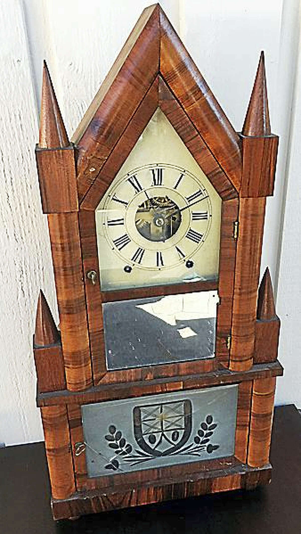 Contributed photo A double steeple clock, part of the many treasures to be found at Tim's Inc. auction Dec. 11.