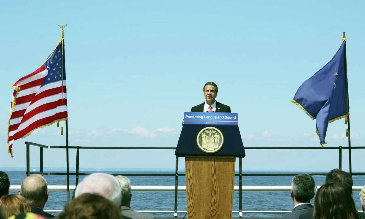 New York Gov. Andrew Cuomo speaks at an event on Thursday, Aug. 4, 2016, at Sunken Meadow State Park in Kings Park, N.Y. Cuomo said Thursday the state would consider legal action if federal officials proceed with plans to expand dumping sites.
