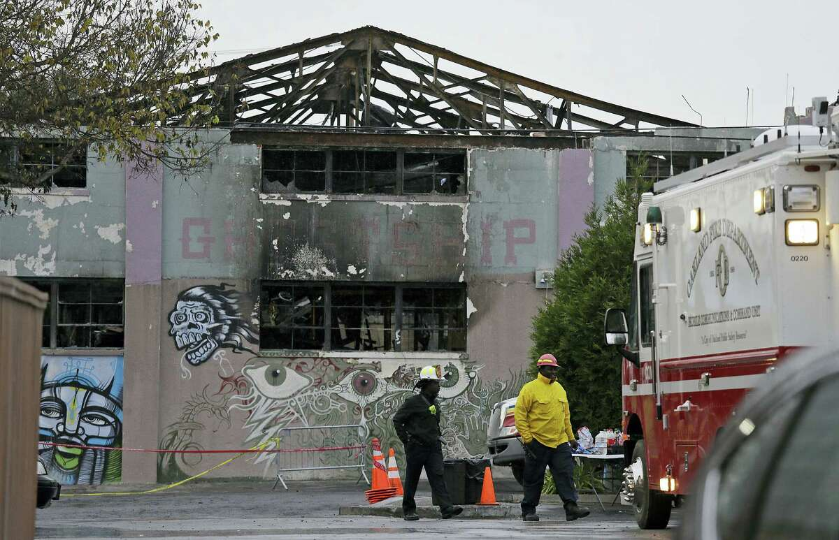 "Oakland fire officials walk past the remains of the Ghost Ship warehouse damaged from a deadly fire in Oakland, Calif. The Dec. 2 fire killed dozens of people during a electronic dance party, after it raced through the building, trapping them inside. For those who survived, it was largely a matter of luck that when the first cries of ""fire"" were heard, they were able to find their way through smoke and darkness or were near enough to a door or already outside."