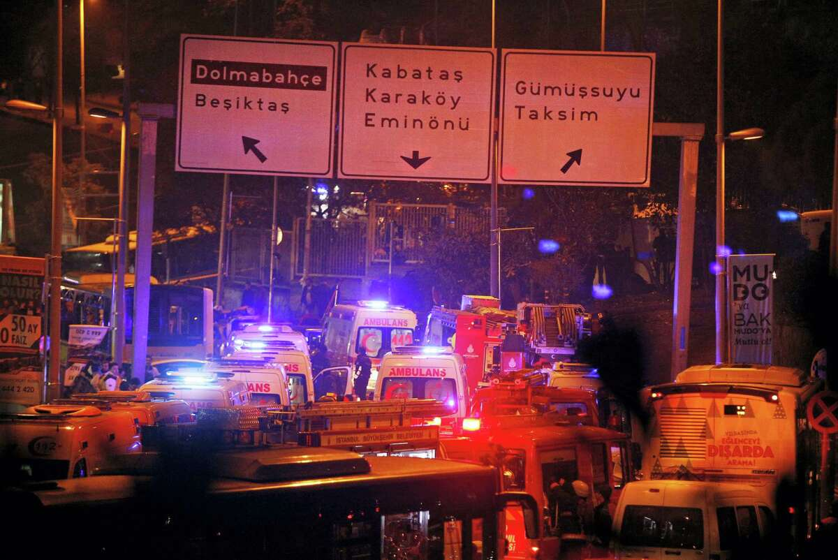 Rescue services rush to the scene of explosions near the Besiktas football club stadium, following at attack in Istanbul, late Saturday, Dec. 10, 2016. Two loud explosions have been heard near the newly built soccer stadium and witnesses at the scene said gunfire could be heard in what appeared to have been an armed attack on police. Turkish authorities have banned distribution of images relating to the Istanbul explosions within Turkey.