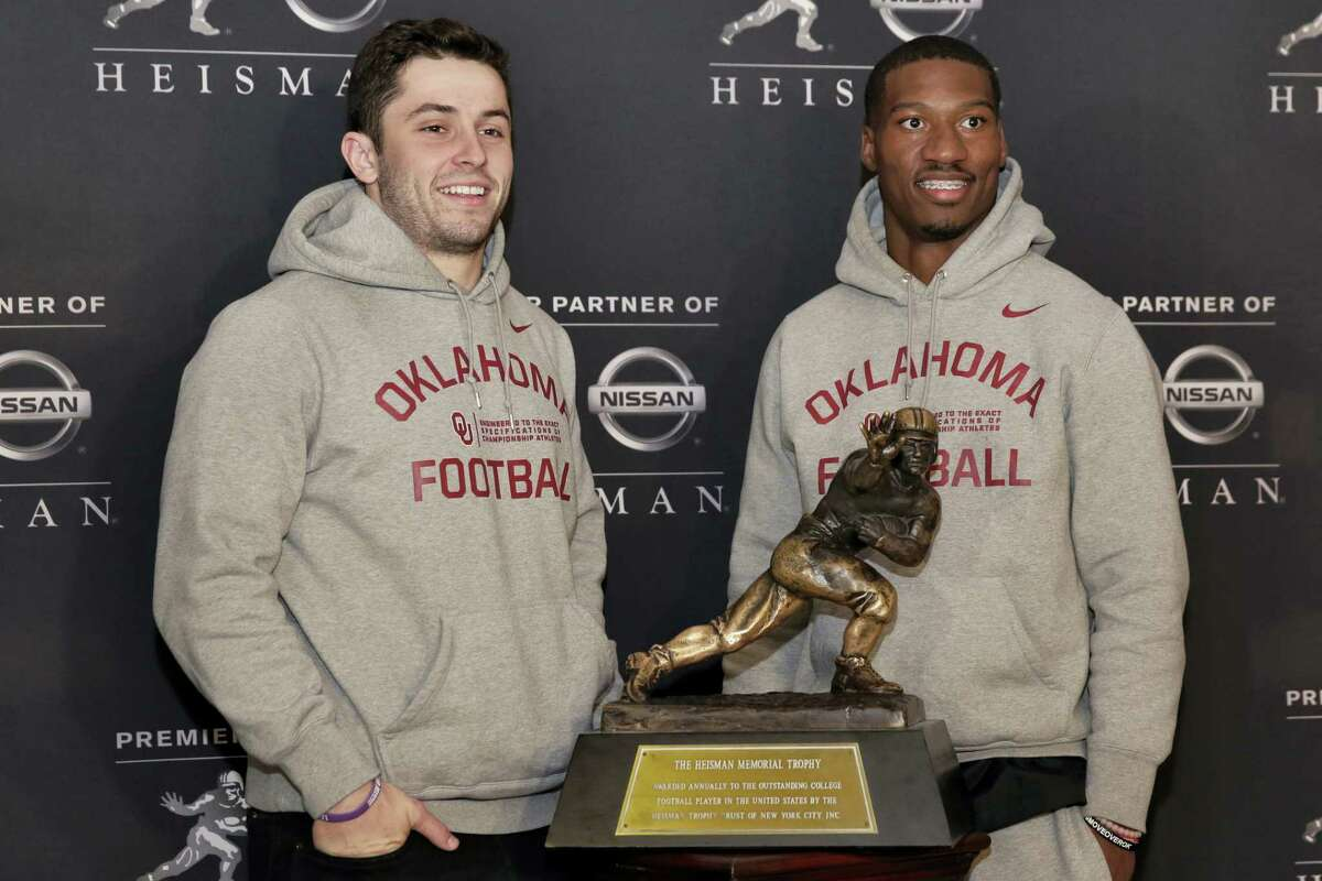 Heisman Trophy finalists from Oklahoma Baker Mayfield, left, and Dede Westbrook, pose with the award in New York on Friday.