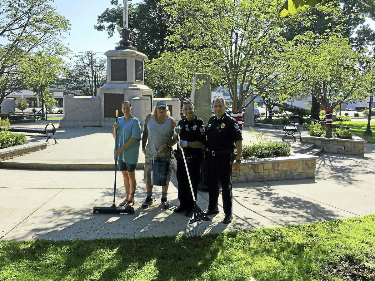 Ben Lambert - The Register CitizenVolunteers and members of the Torrington Police Department lent a hand cleaning up Coe Park Friday, as the first step in an effort to beautify the downtown.