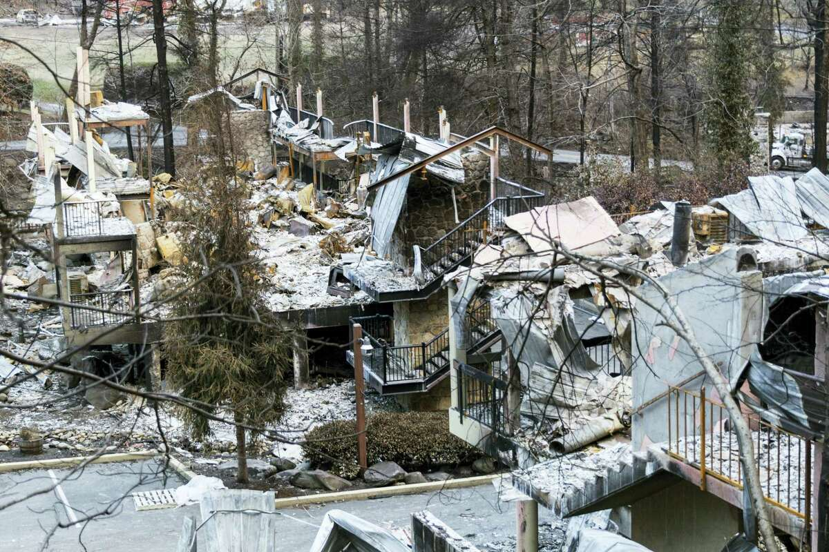 A burned resort is seen in a heavily damaged neighborhood in Gatlinburg, Tenn., on Friday, Dec. 9, 2016. The resort town reopened to the public for the first time since wildfires on Nov. 28.