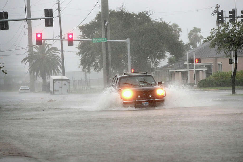 A vehicle navigates a street flooded by rain from Hurricane Harvey.>>Here is a list of the vehicles that might be the most useful, due to clearance, in a flood... / 2017 Getty Images