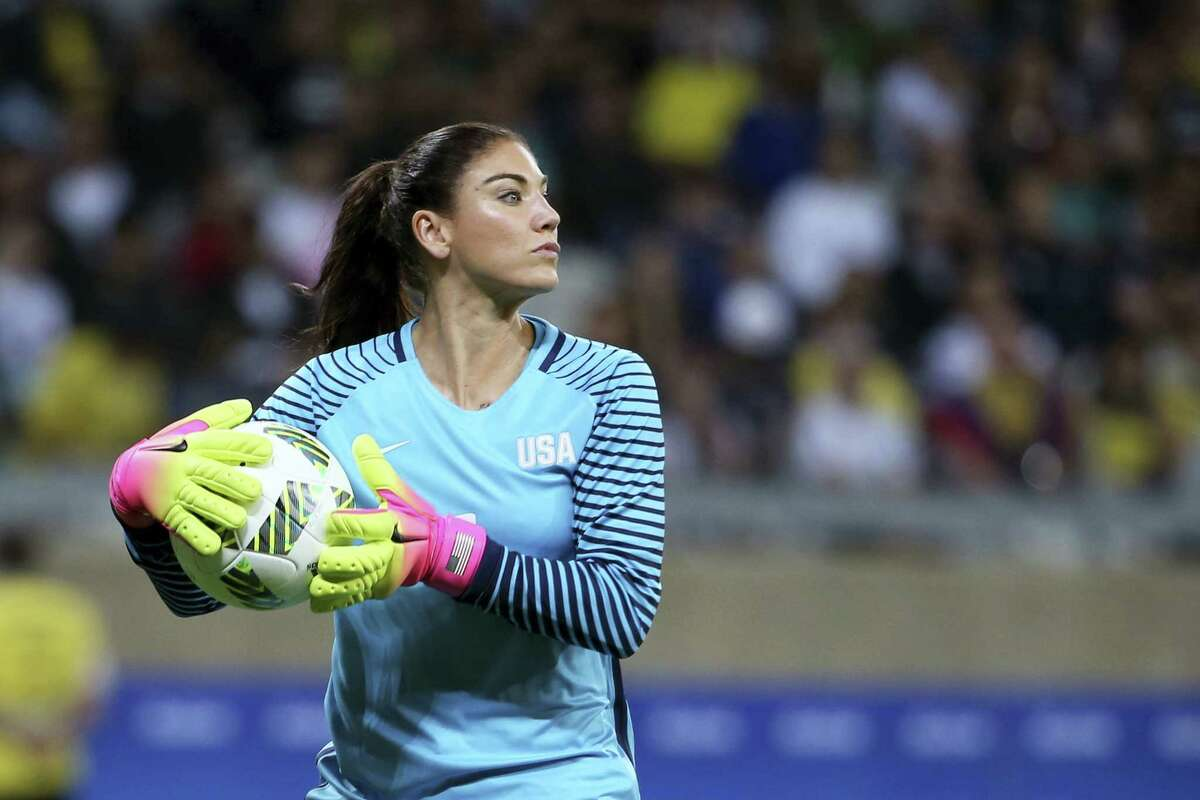 United States goalkeeper Hope Solo takes the ball during a women's Olympic football tournament match against New Zealand at the Mineirao stadium in Belo Horizonte, Brazil on Aug. 3, 2016.