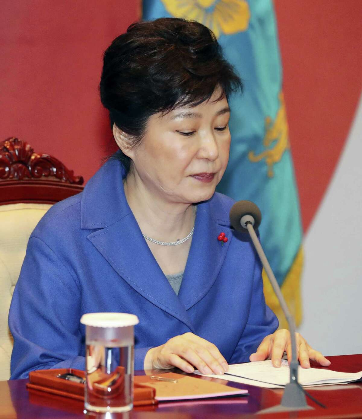 South Korean President Park Geun-hye attends an emergency Cabinet meeting at the presidential office in Seoul, South Korea, Friday, Dec. 9, 2016. South Korean lawmakers on Friday voted to impeach Park, a stunning and swift fall for the country's first female leader amid protests that drew millions into the streets in united fury.