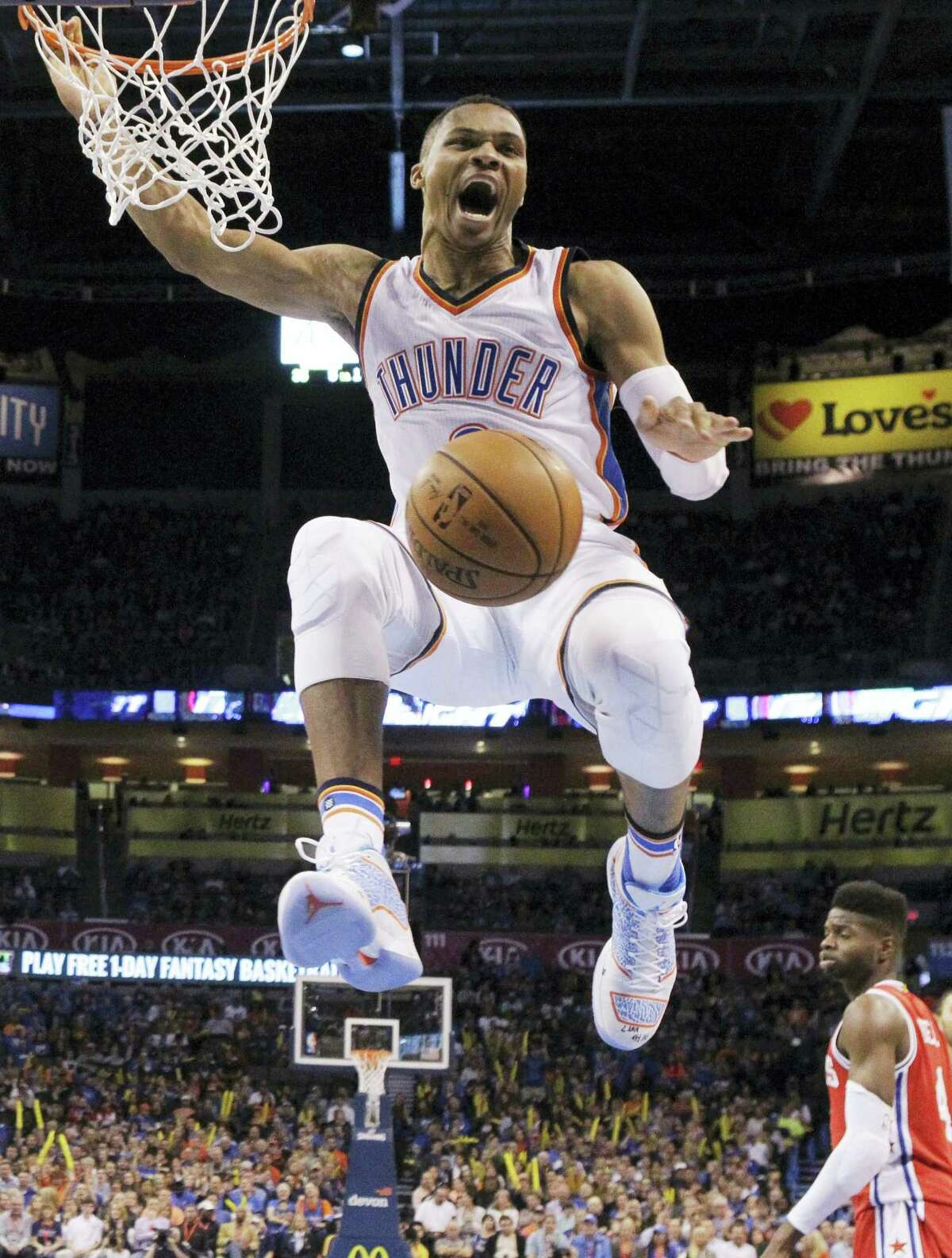 In this Nov. 13, 2015 photo, Oklahoma City Thunder guard Russell Westbrook celebrates following a dunk during the second quarter of an NBA basketball game against the Philadelphia 76ers, in Oklahoma City.