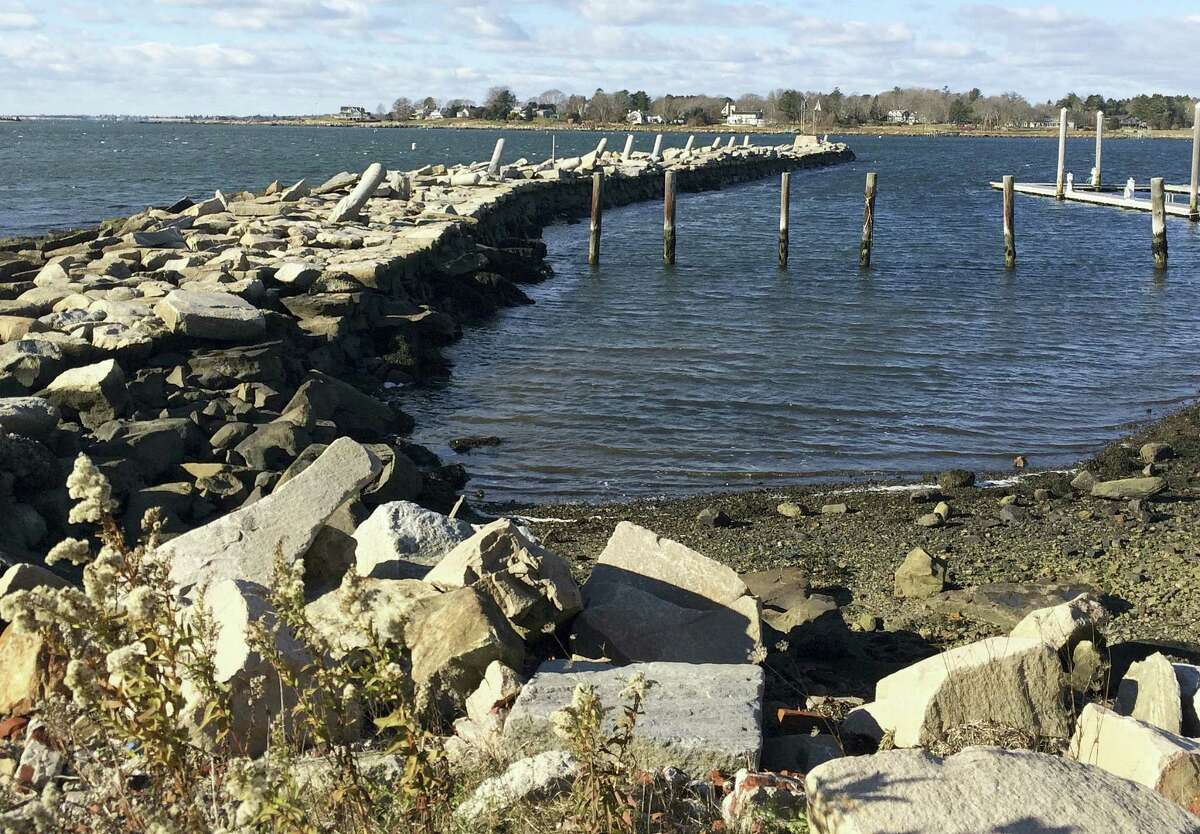 The Stonington Town Wharf sits along the harbor Friday in Stonington. The wharf, built from massive stones in 1827, is seen as key to protecting the harbor during storms.