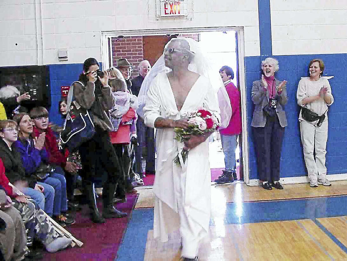 (Photo courtesy of Dennis Jackson) Robert Chatfield Sr. at a basketball game in Amenia, New York in 2000. He showed up in a full wedding gown as a gag, much to the amusement of the crowd. Chatfield died Thursday in a car accident in the Lakeville section of Salisbury.