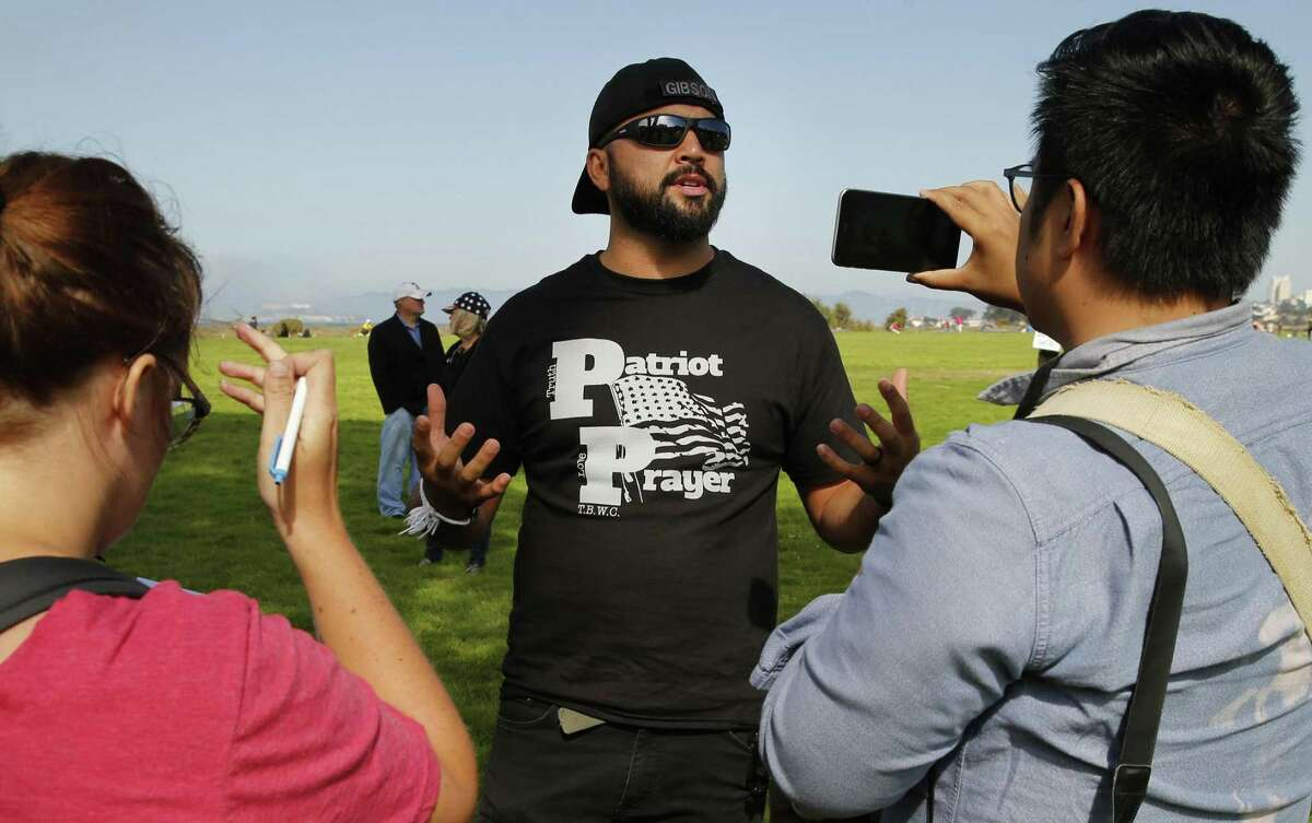 Joey Gibson makes a statement at Crissy Field following the cancellation of the Patriot Prayer event on Saturday, Aug. 26, 2017, in San Francisco, Calif.