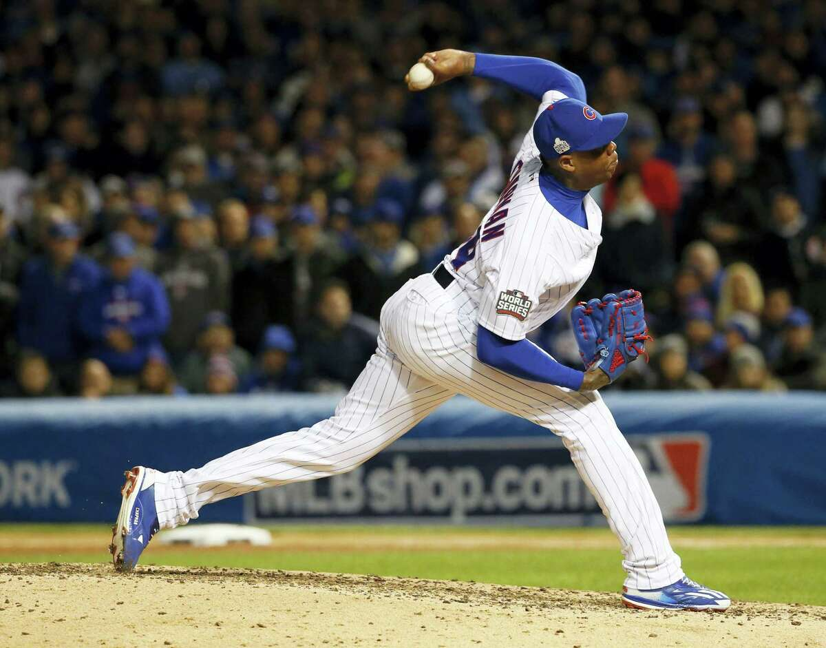 In this Oct. 30, 2016 photo, Chicago Cubs relief pitcher Aroldis Chapman throws during the seventh inning of Game 5 of the Major League Baseball World Series against the Cleveland Indians, in Chicago. Chapman reached agreement to return to the New York Yankees on Dec. 7, 2016 with the highest-priced contract ever for a relief pitcher, an $86 million deal for five years, a person familiar with the negotiations told The Associated Press.