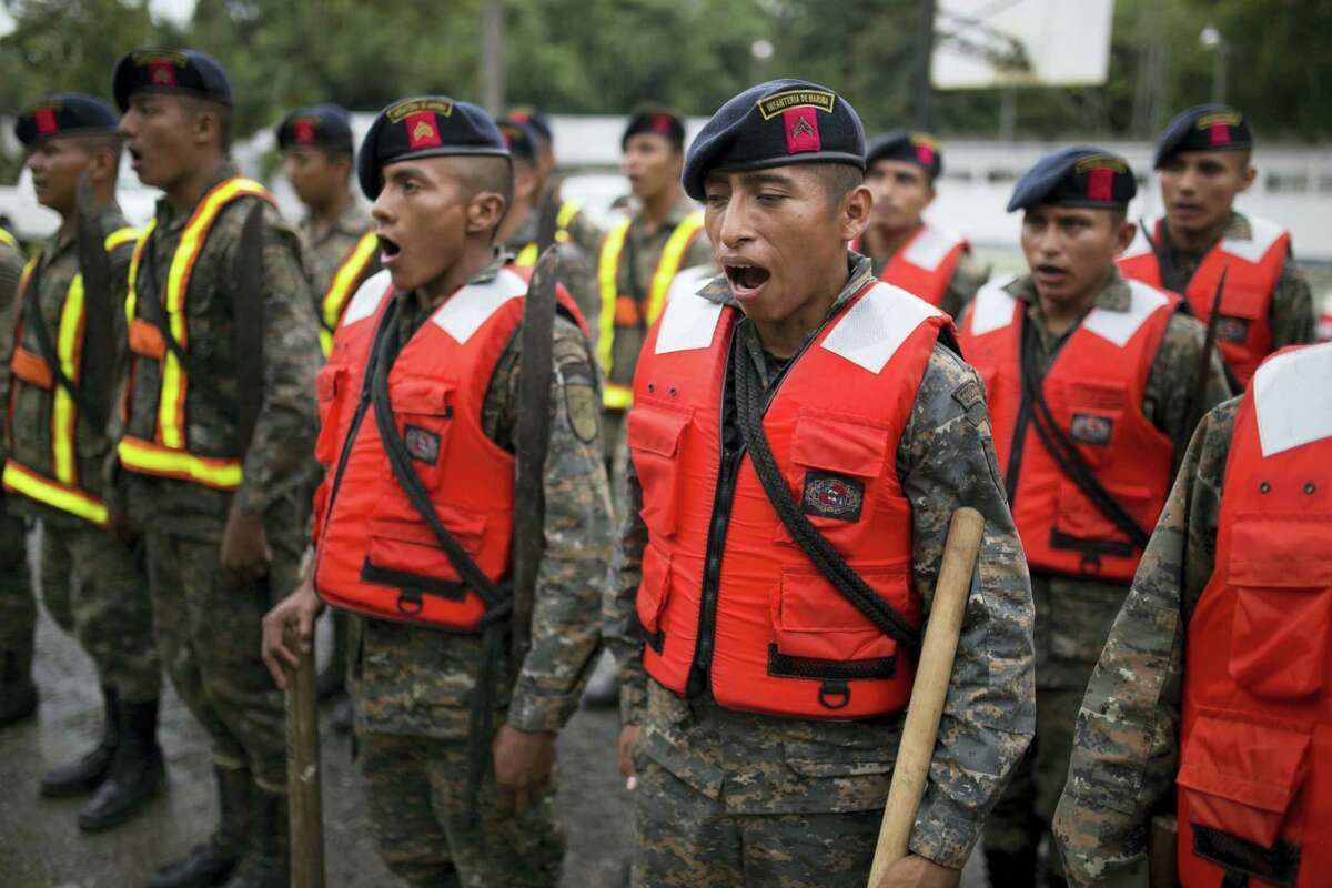 Guatemalan army soldiers sing as they stand for review at their base, before the arrival of Hurricane Earl in Puerto Barrios, Guatemala, Tuesday, Aug. 3, 2016. Hurricane Earl bore down on the coast of the Caribbean nation of Belize with the danger of high surf and winds, while also threatening neighboring Guatemala and southern Mexico with torrential rains. Earl has since been downgraded to a tropical storm.