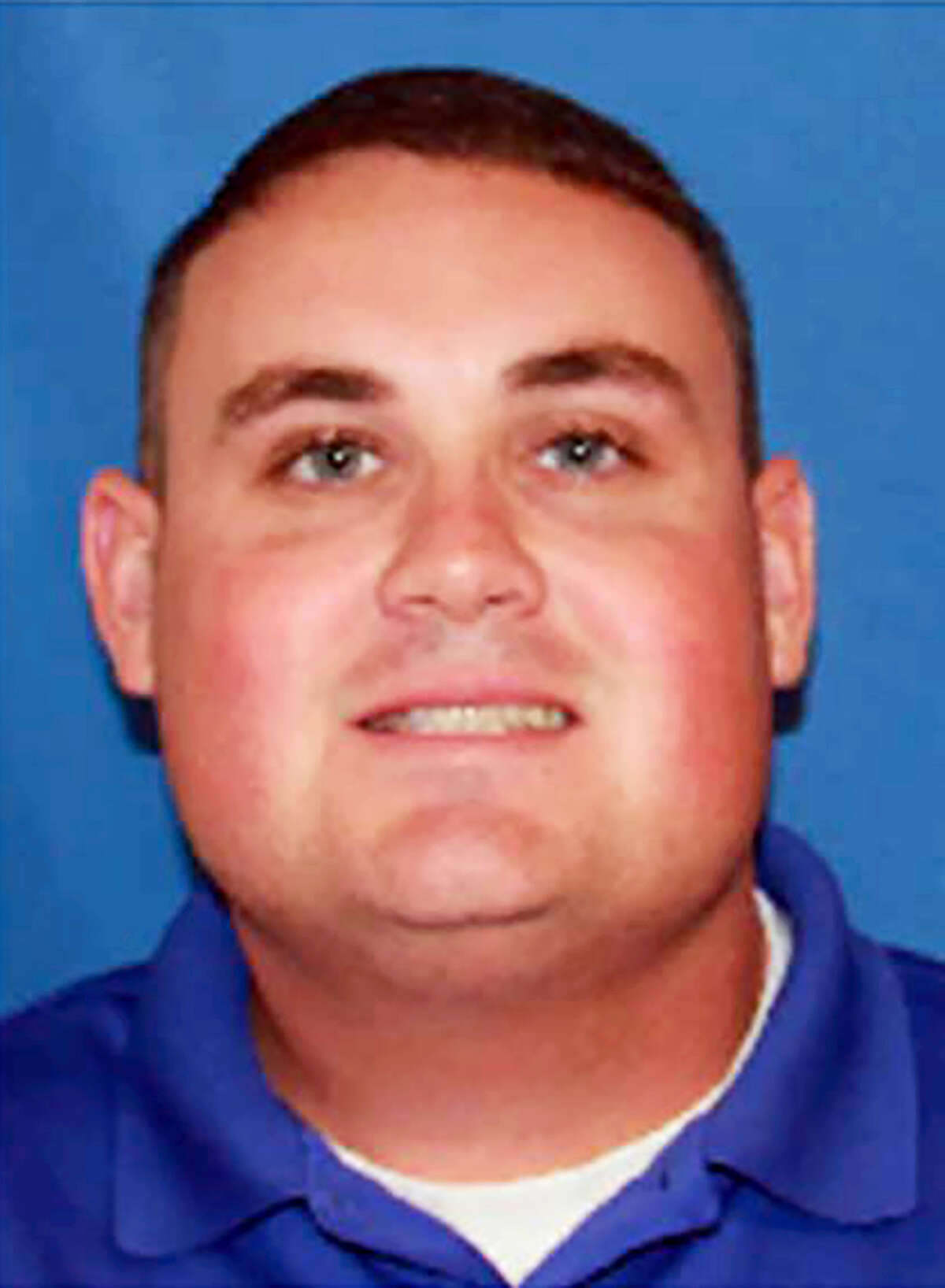 This undated image provided by Georgia Southwestern State University shows campus police officer Jody Smith. The manhunt for 32-year-old Minquell Lembrick ended a Thursday, Dec. 8, 2016, they day after the alleged gunman killed Americus police Officer Nicholas Smarr and Officer Jody Smith of Georgia Southwestern State University. Both officers were shot as they responded to a domestic disturbance call in Americus, a rural city 130 miles south of Atlanta.