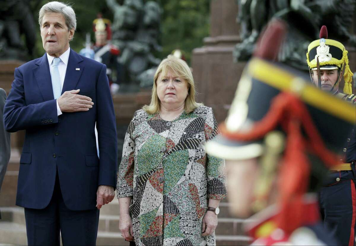 U.S. Secretary of State John Kerry, left, and Argentina's Foreign Minister Susana Malcorra, attend a wreath-laying ceremony at Plaza San Martin square to pay homage to Argentine XIX century hero General Jose de San Martin, in Buenos Aires, Argentina, Thursday, Aug. 4, 2016. During his visit Kerry will also meet with the country's president before heading to Brazil to to lead the U.S. Presidential Delegation to the Opening Ceremony of the 2016 Olympic Summer Games.