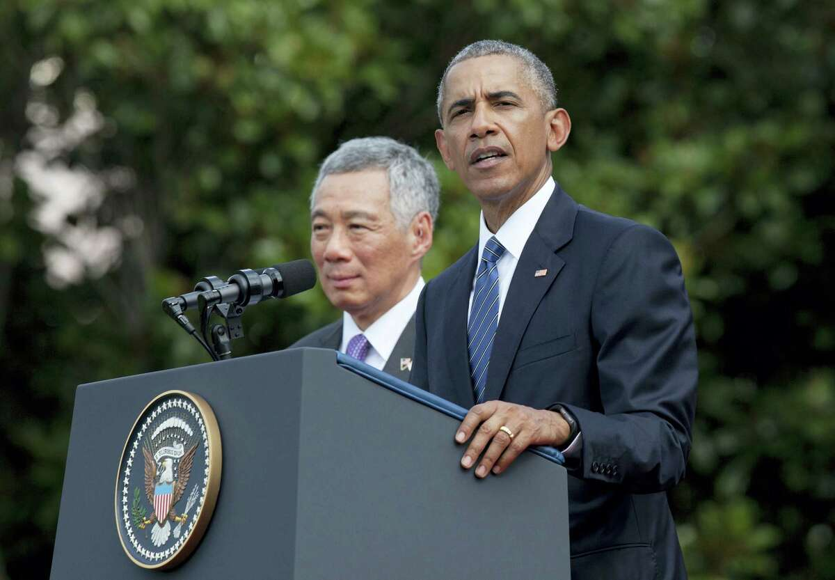 President Barack Obama, with Singapore's Prime Minister Lee Hsien Loong, speaks during a state arrival ceremony for the Singaporean prime minister on the South Lawn of the White House in Washington Tuesday.