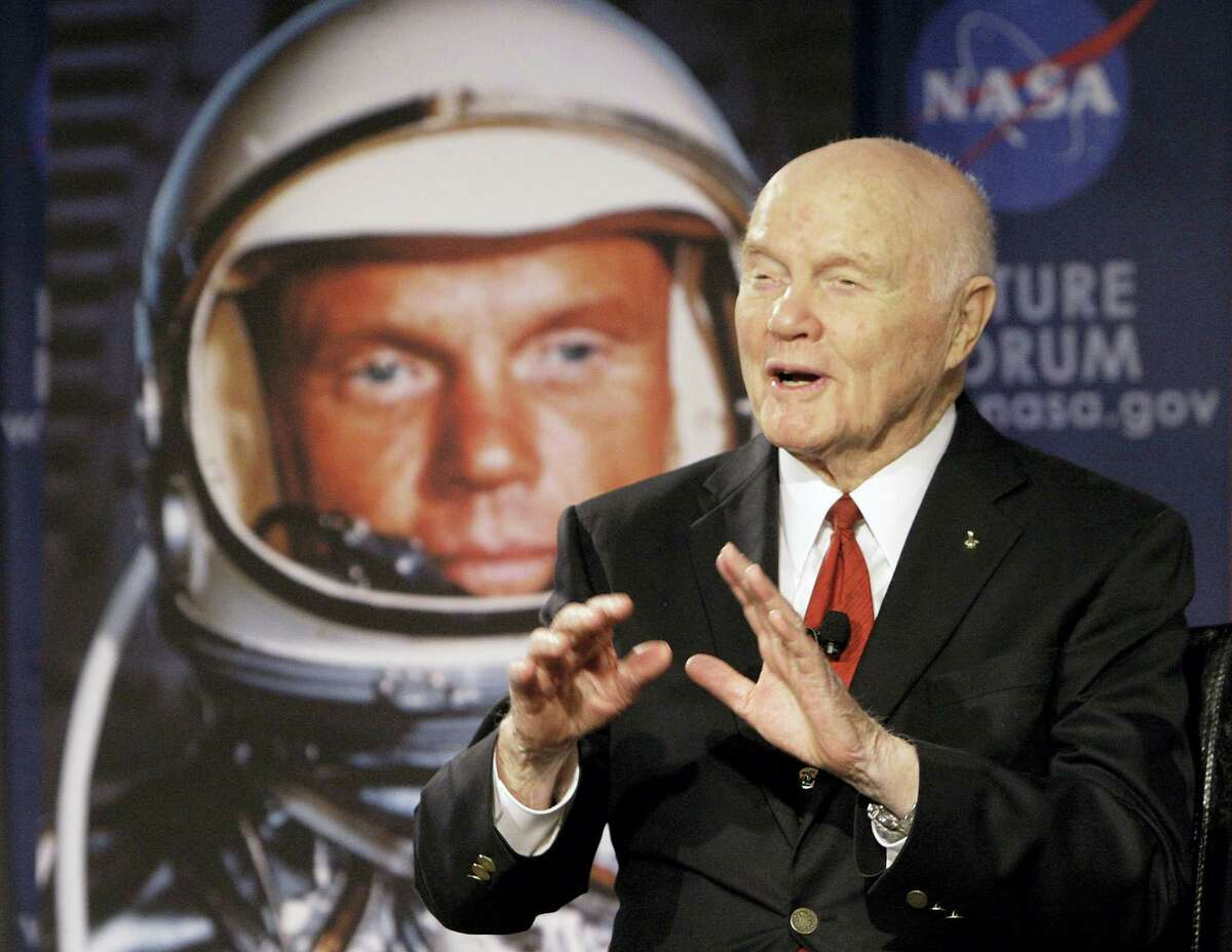 """In this file photo, U.S. Sen. John Glenn talks with astronauts on the International Space Station via satellite before a discussion titled """"Learning from the Past to Innovate for the Future"""" in Columbus, Ohio. Glenn, who was the first U.S. astronaut to orbit Earth and later spent 24 years representing Ohio in the Senate, has died at 95."""