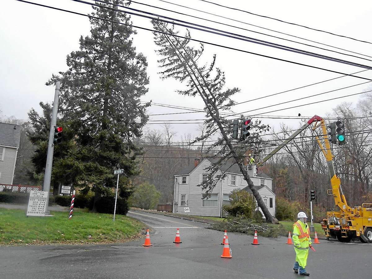 File photo - The Register Citizen Connecticut Light & Power crews work on fallen trees and lines in the wake of Hurricane Sandy, on Winsted Road at the intersection of Burrville Pond Road in Torrington, in 2012. The Torrington City Council recently approved a disaster mitigation plan developed by the Northwest Hills Council of Governments that addresses such natural and sometimes catastrophic events.