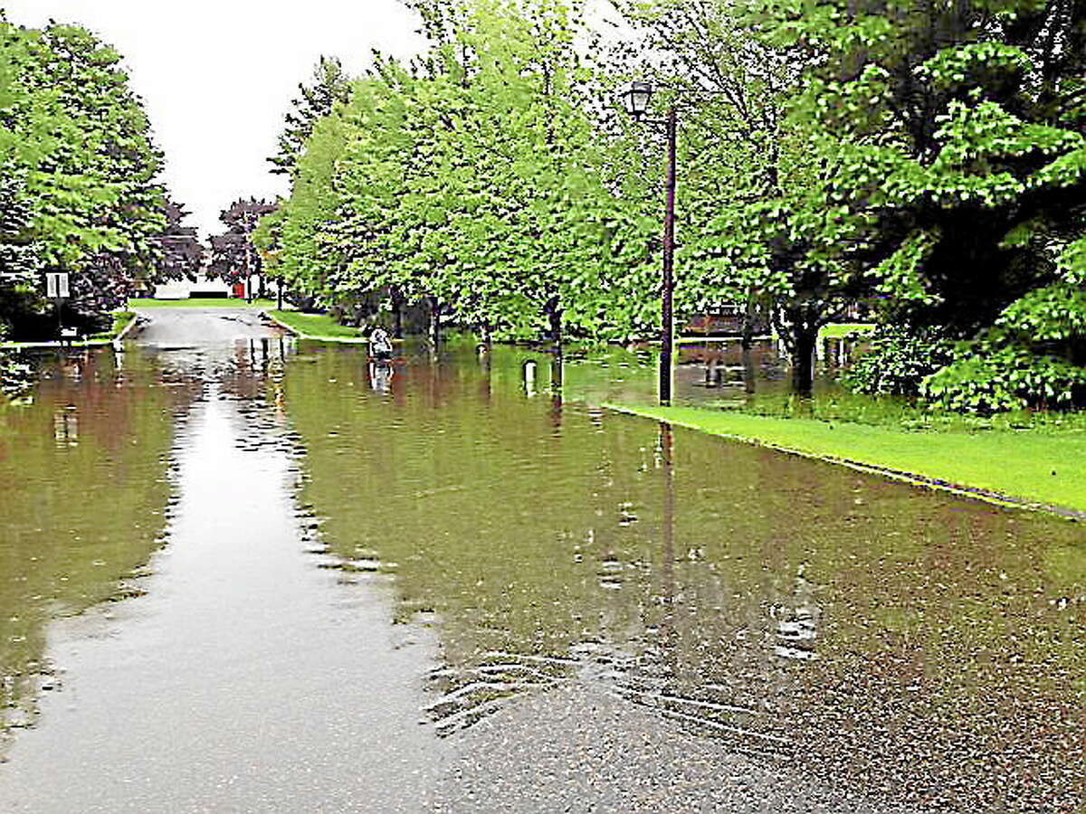 File photo - The Register Citizen Flooding, a concern in the Northwest Corner towns including Torrington, is addressed in a disaster mitigation plan developed by the Northwest Hills Council of Governments. Members of the Torrington City Council adopted its portion of the regional plan this week.
