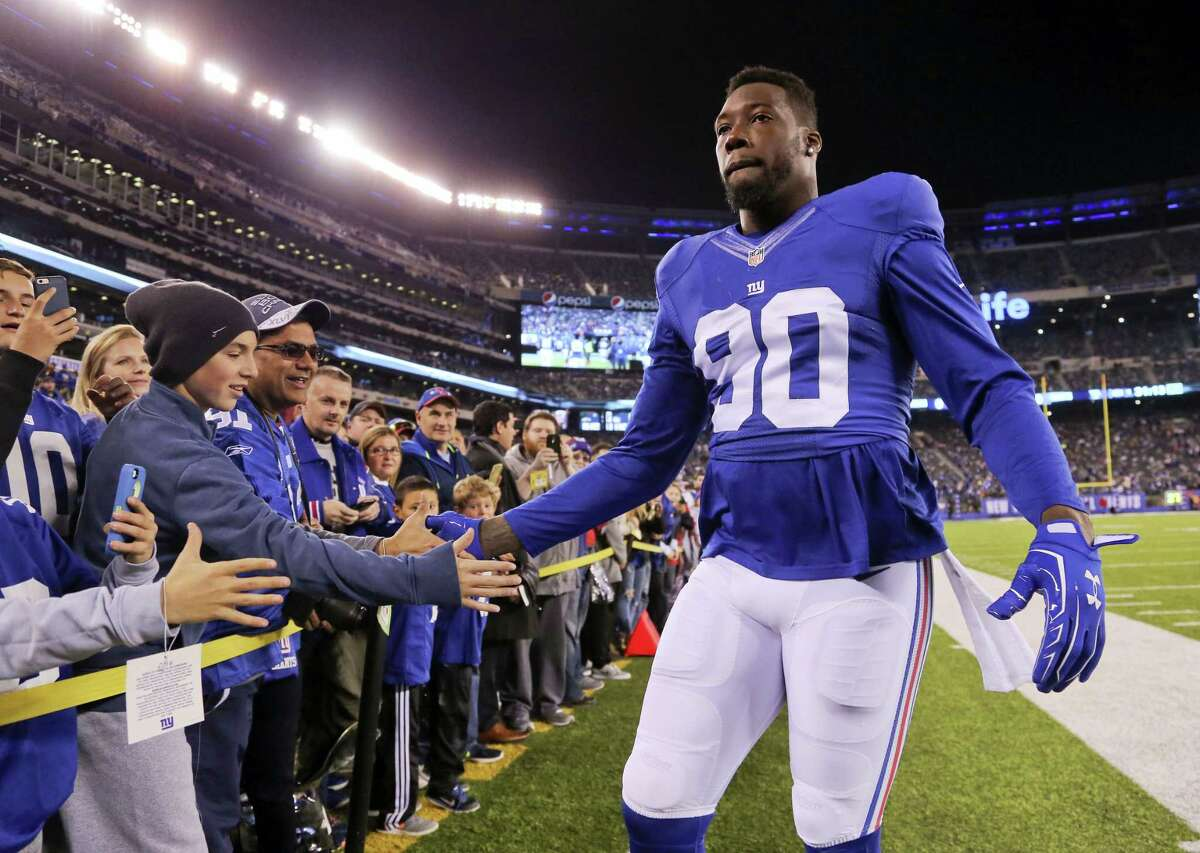 In this Nov. 14 file photo, New York Giants defensive end Jason Pierre-Paul greets fans before an NFL football game against the Cincinnati Bengals in East Rutherford, N.J. Pierre-Paul is going to miss the rest of the regular season after surgery to repair a sports hernia. The 27-year-old old tweeted on Wednesday that he had surgery and was feeling well.