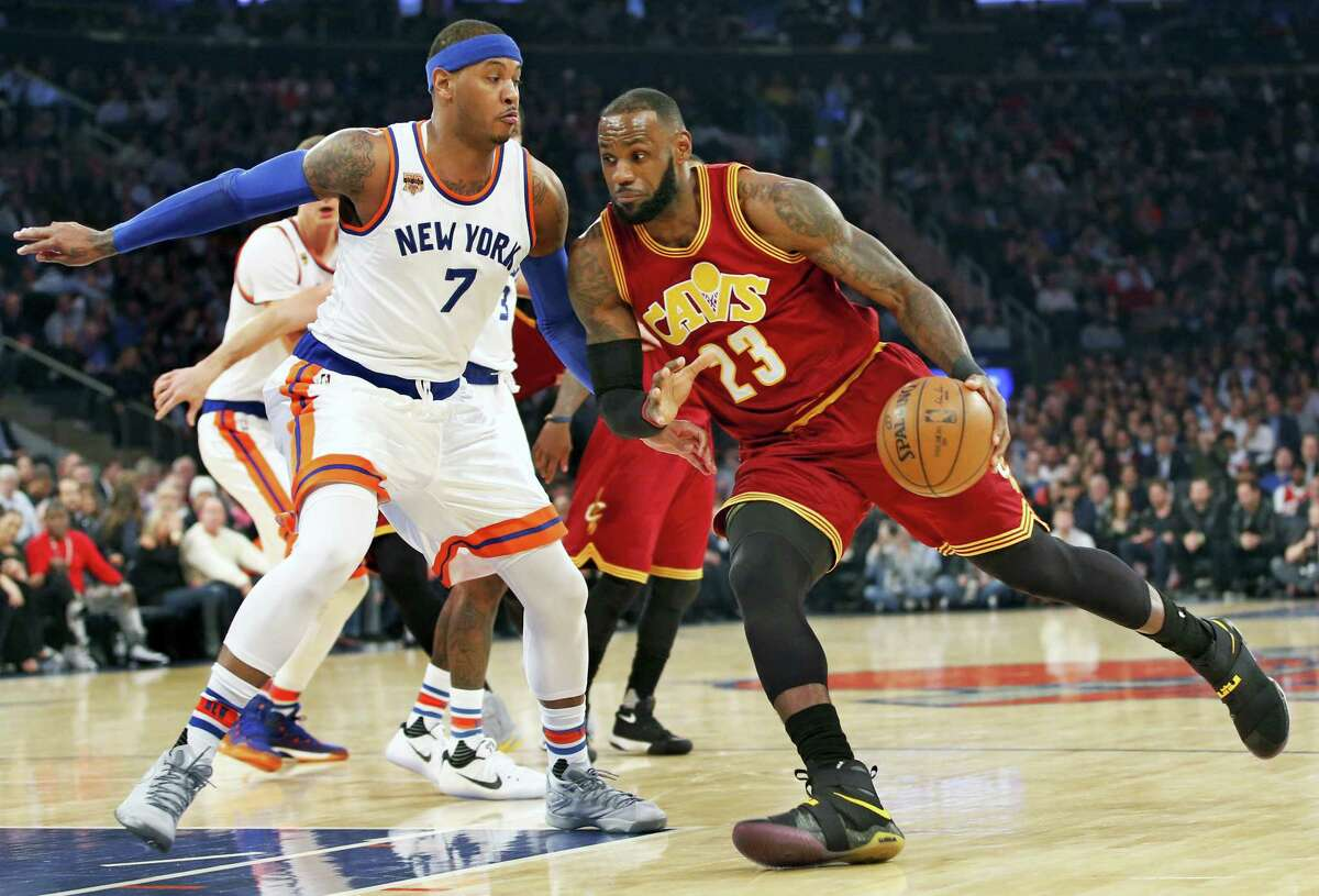 Cleveland Cavaliers forward LeBron James drives to the basket with New York Knicks forward Carmelo Anthony defending in the first quarter of an NBA basketball game at Madison Square Garden in New York Wednesday. The Cavs hammered the Knicks 126-94.