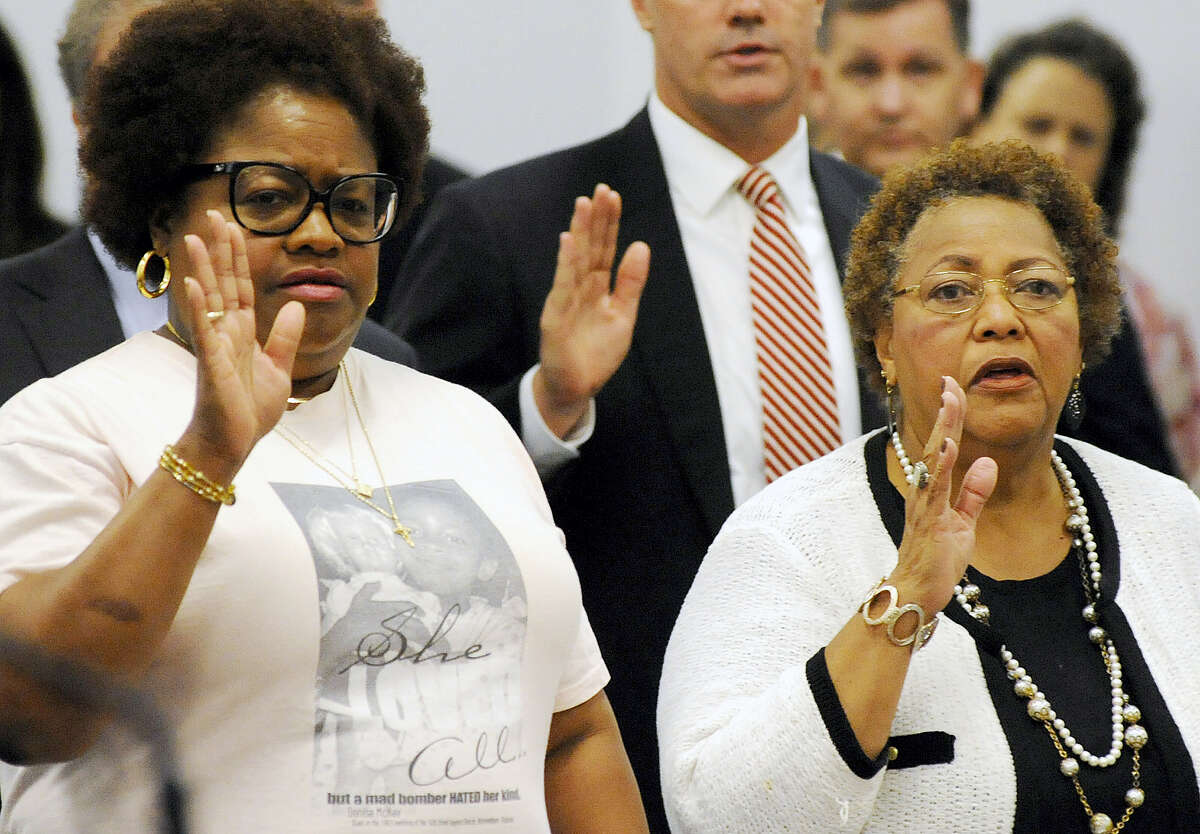 Lisa McNair, left, and Dianne Robertson Braddock are sworn-in before speaking to Alabama's parole board about the possible release of convicted church bomber Thomas Blanton Jr. in Montgomery, Ala., on Wednesday, Aug. 3, 2016. McNair is a sister of bombing victim Denise McNair, and Braddock is a sister of victim Carole Robertson. The board agreed with the women and denied parole for Blanton. (AP Photo/Jay Reeves)