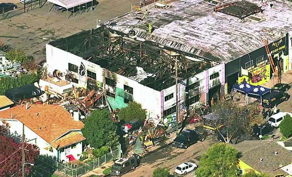 This Dec. 3, 2016, image from video provided by KGO-TV shows the Ghost Ship Warehouse after a fire that started late Friday swept through the Oakland, Calif., building. Dozens of people are confirmed dead with the toll expected to rise.
