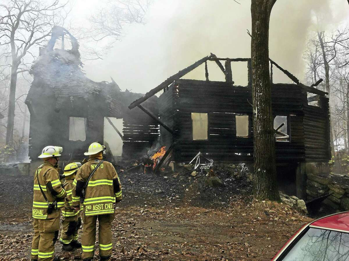 Ben Lambert - The Register CitizenNorfolk firefighters responded to the scene of a house on fire earlier this morning on Estey Road in Norfolk. No one was injured; the house was still burning at 11 a.m. but the fire has been contained.