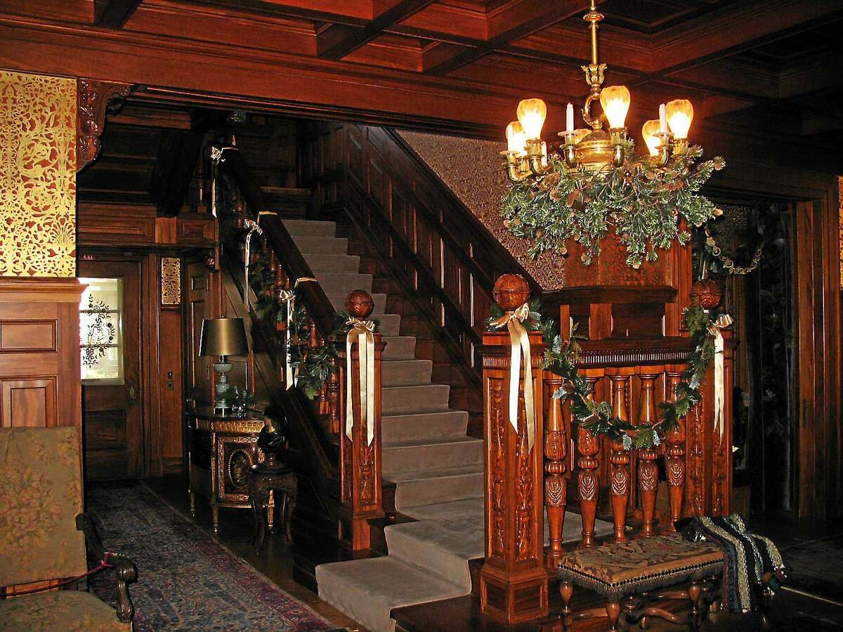 Contributed photos Last year, the grand hallway and staircase of the Hotchkiss-Fyler House was decorated with greenery and ribbons. The society is busy decorating the house with a new theme for this year's tours.