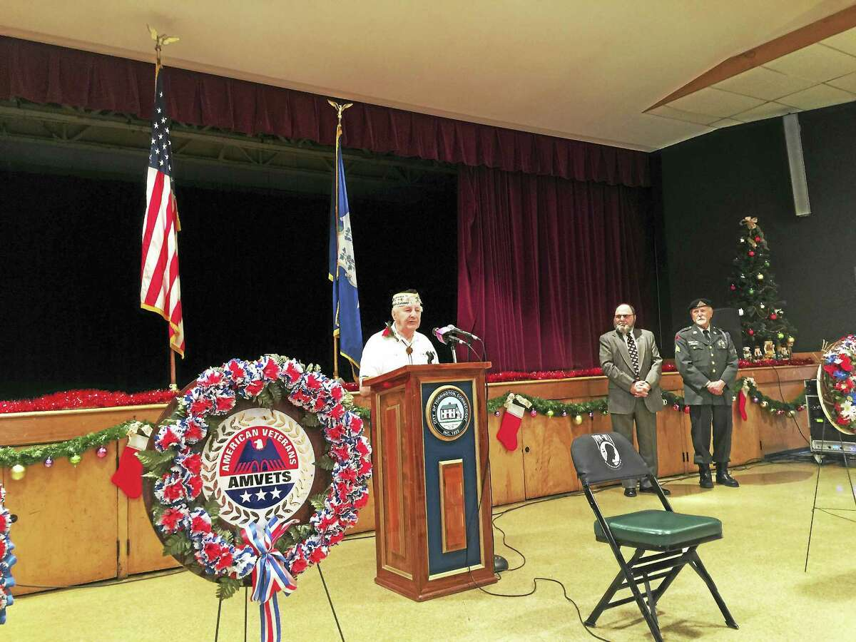 Ben Lambert - The Register CitizenThe 75th anniversary of the attack on Pearl Harbor was marked with a ceremony Wednesday in Torrington. Here, Chief Boatswain Isadore Tadiello, a survivor of the bombing, speaks to those in attendance.