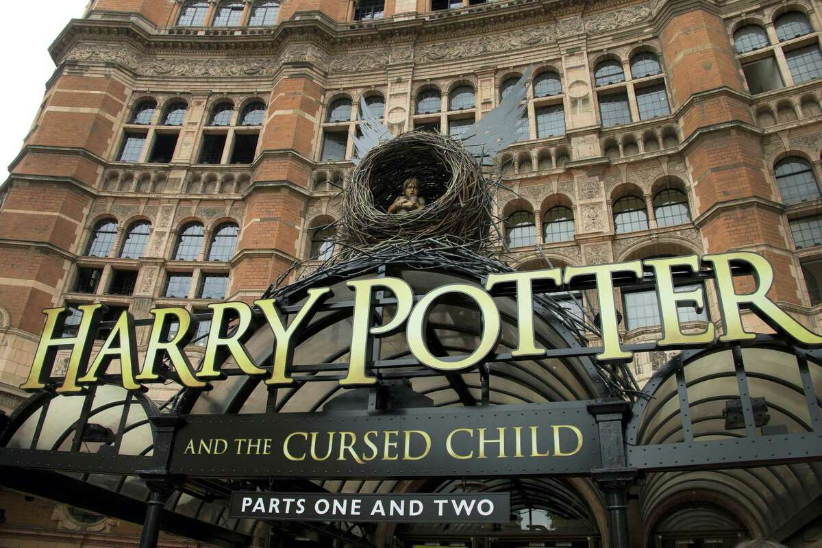 """This July 30, 2016 photo shows the Palace Theatre in central London which is showing a stage production of, """"Harry Potter and the Cursed Child."""" The script """"Harry Potter and the Cursed Child Parts One and Two"""" sold more than 2 million print copies in North America in its first two days of publication, Scholastic announced Wednesday, Aug. 3, 2016."""