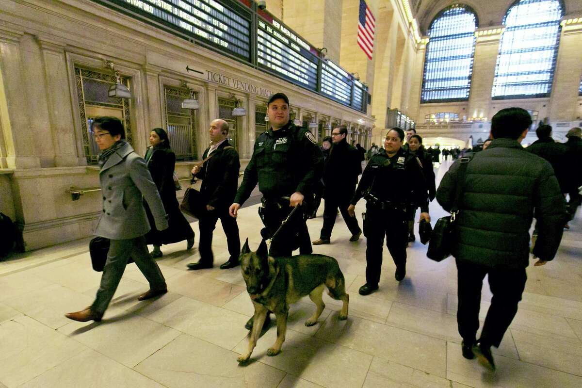 In this March 22 photo, Metro-North Railroad police officers with a police dog patrol Grand Central Terminal in New York.