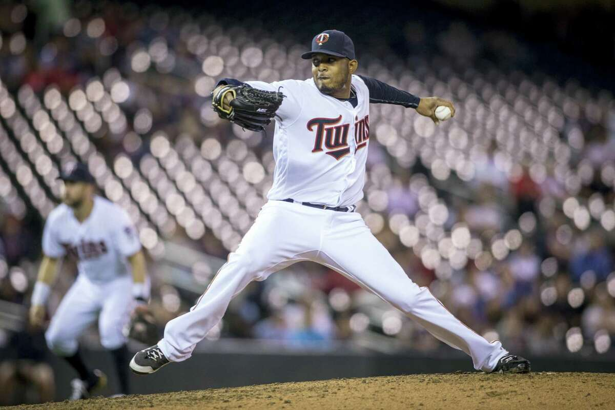 The Boston Red Sox have acquired left-handed reliever Fernando Abad from the Minnesota Twins for minor league pitcher Pat Light.