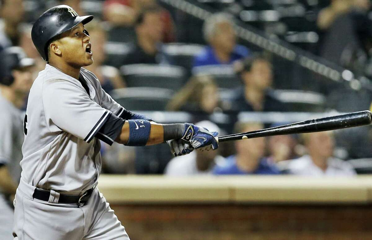 New York Yankees Starlin Castro watches his tenth-inning, sacrifice fly during an interleague game Monday in New York. Jacoby Ellsbury scored the winning run in the Yankees 6-5 victory over the New York Mets.