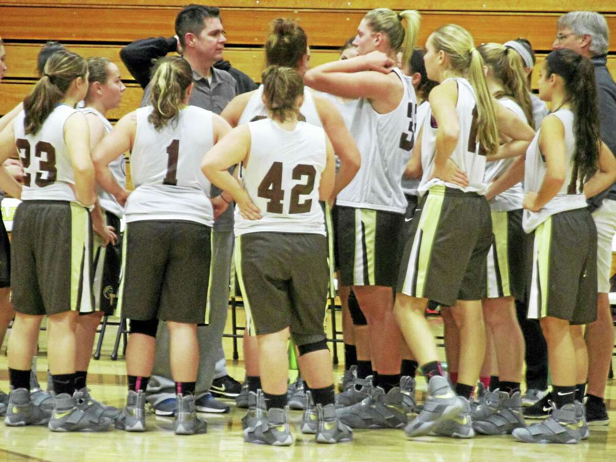 Thomaston head girls basketball coach Bob McMahon talks to the next wave of Golden Bears at practice.