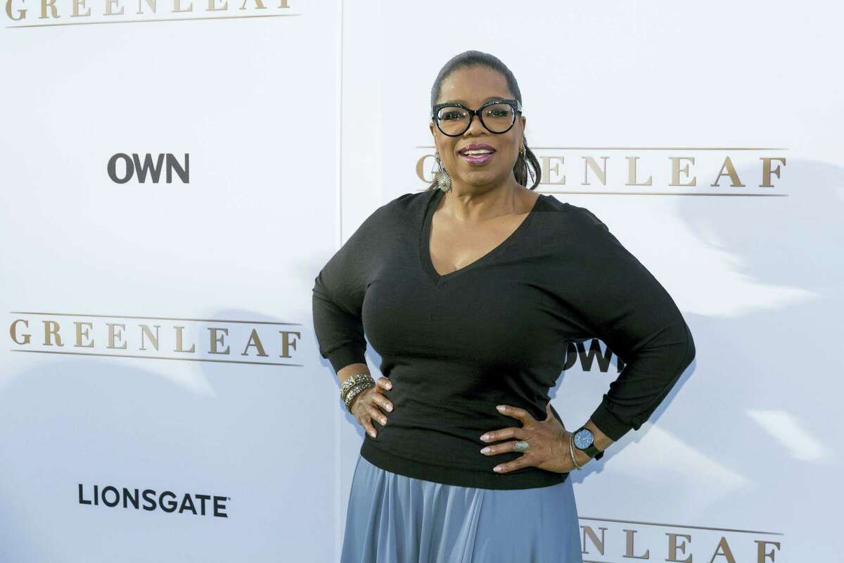 "In this June 15, 2016 photo, Oprah Winfrey arrives at the season one premiere of ""Greenleaf"" at The Lot in West Hollywood, Calif. Winfrey has a new book club pick, Colson Whitehead's ""The Underground Railroad,"" a historical novel that imagines the network of safe houses and passages that helped slaves escape to free territory is an actual train."