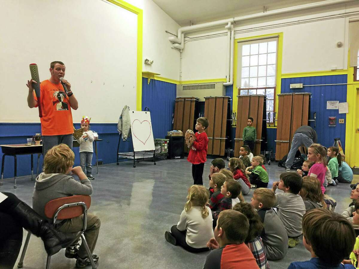 """Ben Lambert - The Register Citizen New Hartford students heard about the importance of treating others with love and kindness Wednesday from Kevin """"Mr. Peace"""" Szawala."""
